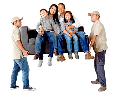 Men carrying a sofa with a family moving house - isolated over a white background